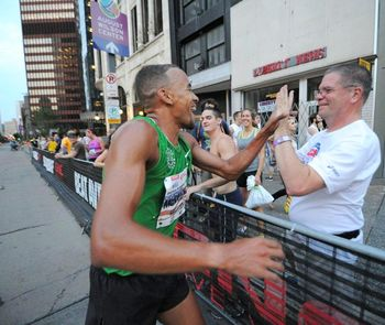 Jordan wins Liberty Mile and gives high five to Coach Mark