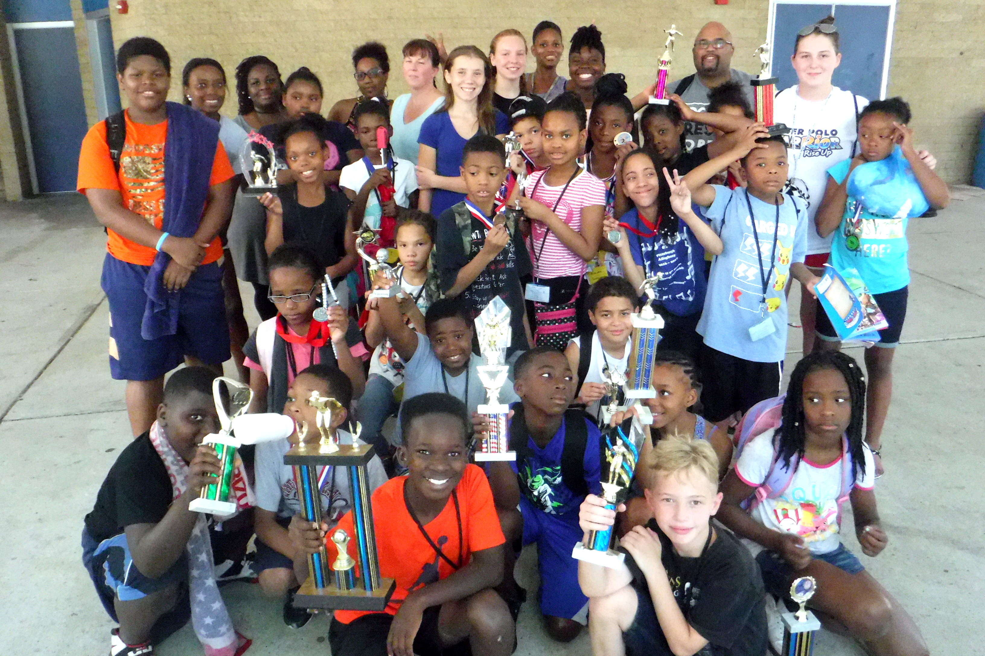 Swimmers with trophies at Swim & Water Polo Camp